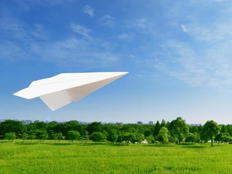 Paper airplane and park