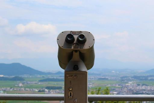 Countryside landscape and telescope