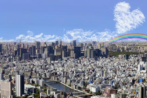 Heart and rainbow of hope on the sky of Tokyo