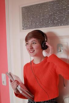 A foreigner model 15 enjoying music