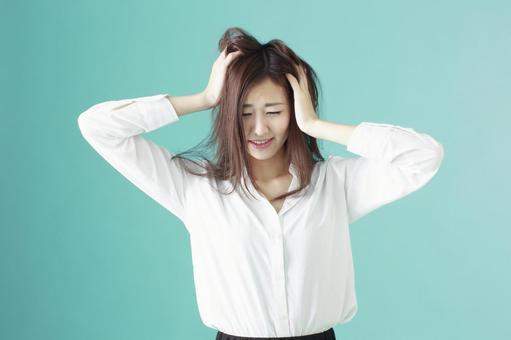 A woman holding a head