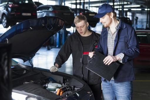 Automobile mechanic checking bonnet 14