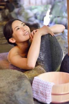 A woman led to an outdoor bath 1