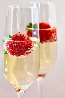 Strawberry champagne cocktail (white background)
