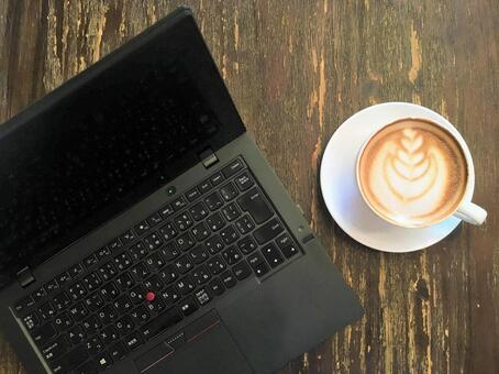 Coffee, computer and wood table