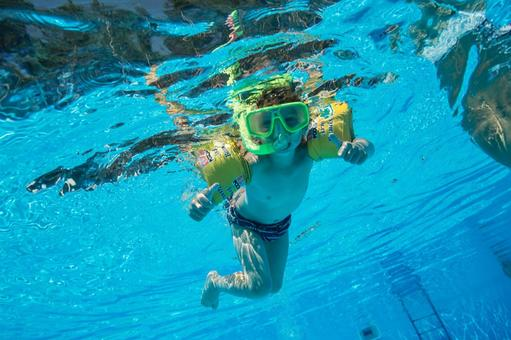 Boys dive in the pool with snorkel 2