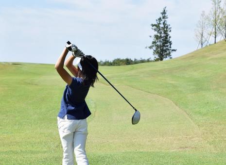 Junior golfer's tee shot