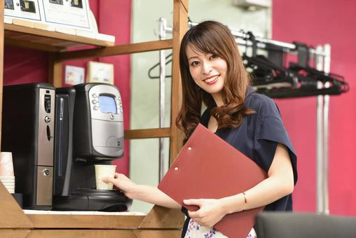 Business woman making coffee in the office