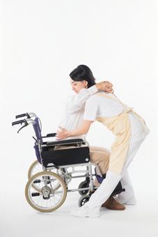 A nurse and a wheelchair male 10