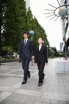 Walking businessman, business woman 3