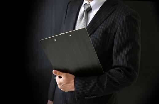 Businessman with binder