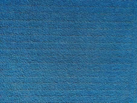 Dark blue carpet-like background, texture