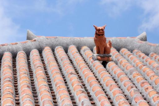 Okinawa sky and shisa on a tiled roof