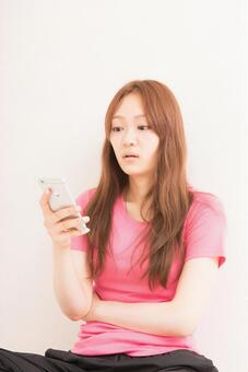 A woman using a smartphone 2