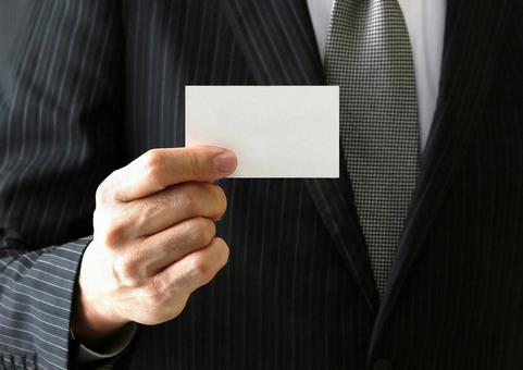 Businessman with business card (up)