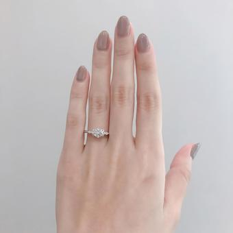 Woman's hand with an engagement ring