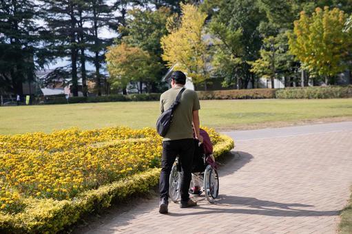 A man pushing a wheelchair