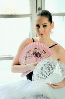 A woman with a fan 1
