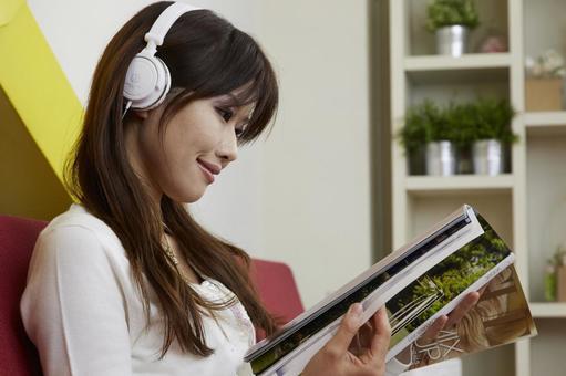 A woman watching a magazine 38