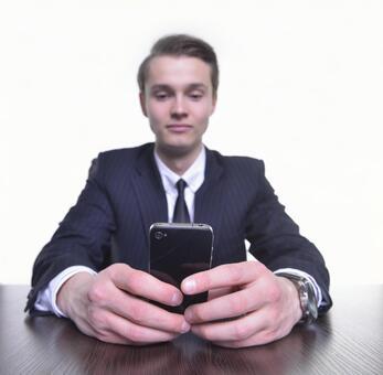 Businessman operating smartphone 12