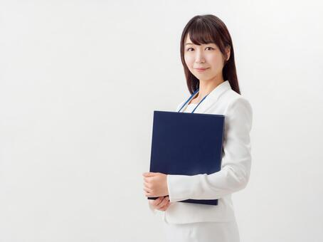 Image of a young career woman with a file