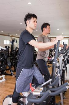 Men walking in a gym