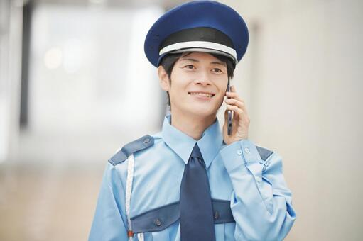 Security guard on the phone