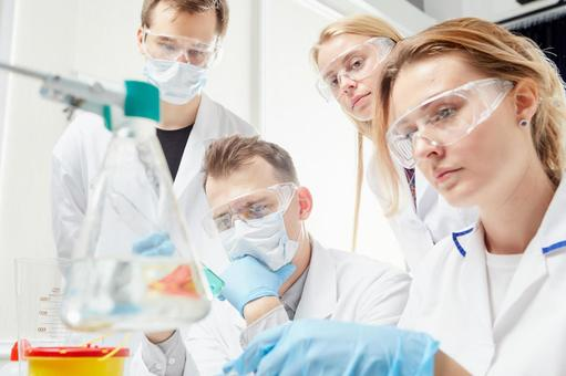 Group of researchers conducting experiments