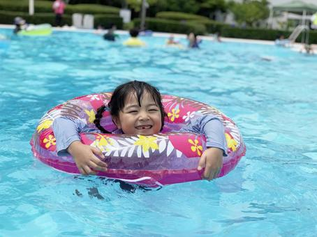 Girl floating on a float in the pool