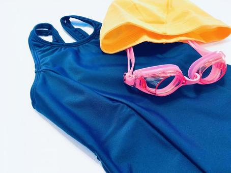 Swimsuit, swim cap and goggles