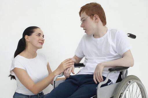 Wheelchair boy and mom