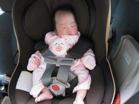 Baby sleeping in child seat