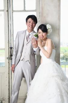 Bride and bridegroom showing wedding ring 1