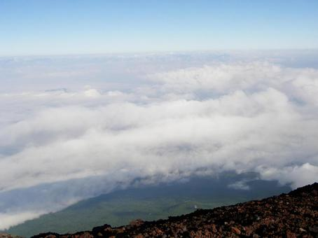 Scenery from the top of Mt. Fuji (sea of clouds) Be careful of slipping! Image Stock Photos Overlooking Mt. Fuji