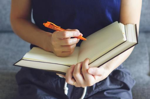 Woman writing in a notebook 2