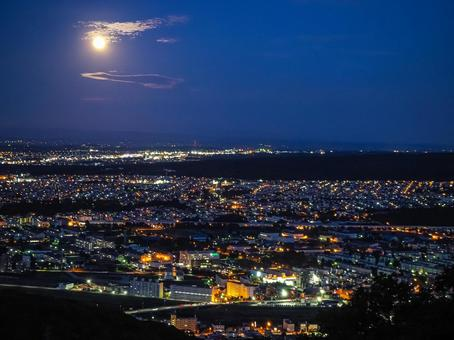 Night view of the moon and Sapporo