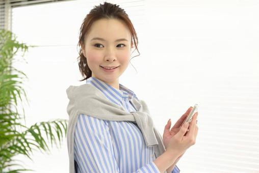 Career woman using a smartphone 6