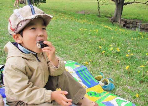 Boy eating rice ball