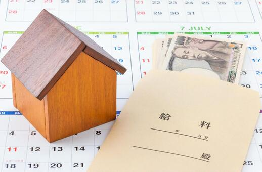 Image of mortgage repayment plan / rent payment (house model, salary and calendar)