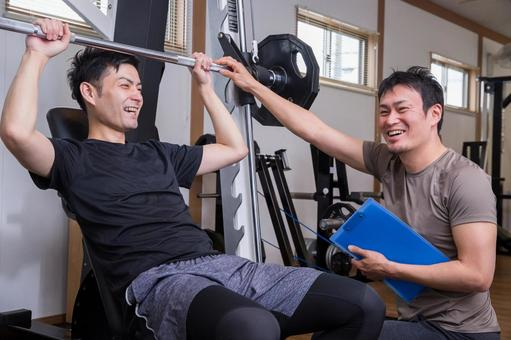 Men receiving counseling at a gym