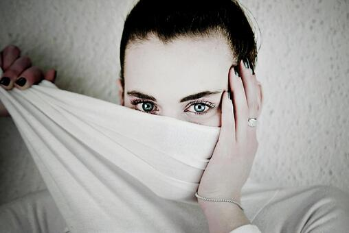 Woman hiding face with cloth 3