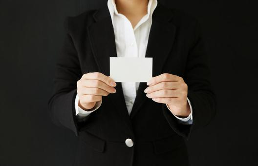 A woman with a business card (card) with both hands