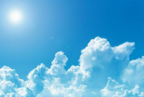 Summer blue sky with strong sunlight and transparent white entrance clouds