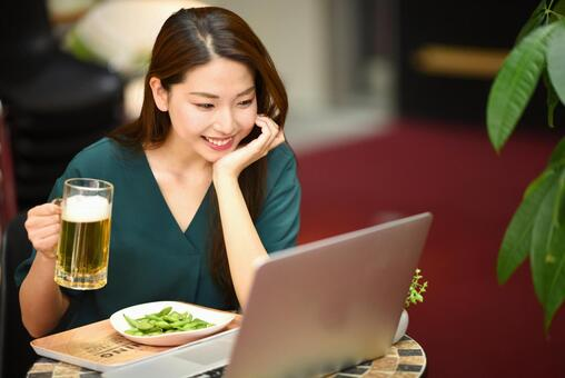 Women having a drinking party online