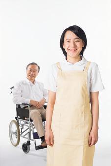 A nurse and a wheelchair male 1