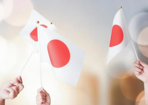 Image of cheering with the small flag of the Hinomaru