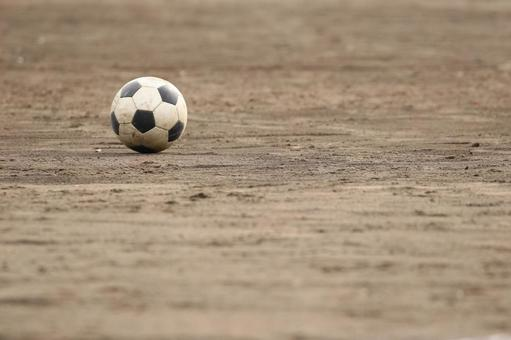 Soccer ball and ground