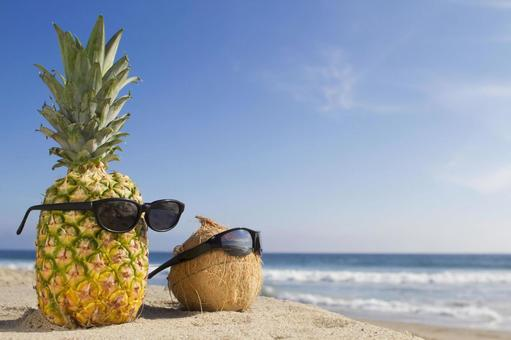 Summer image, pineapple and coconut with sunglasses