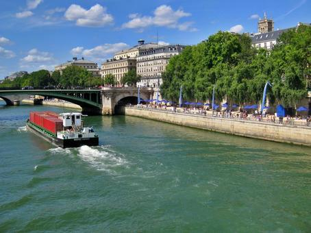 Seine river and ship in the blue sky