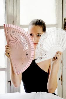 A woman with a fan 11